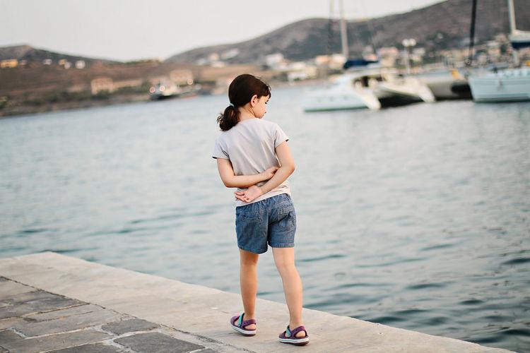 Full length of girl walking on pier