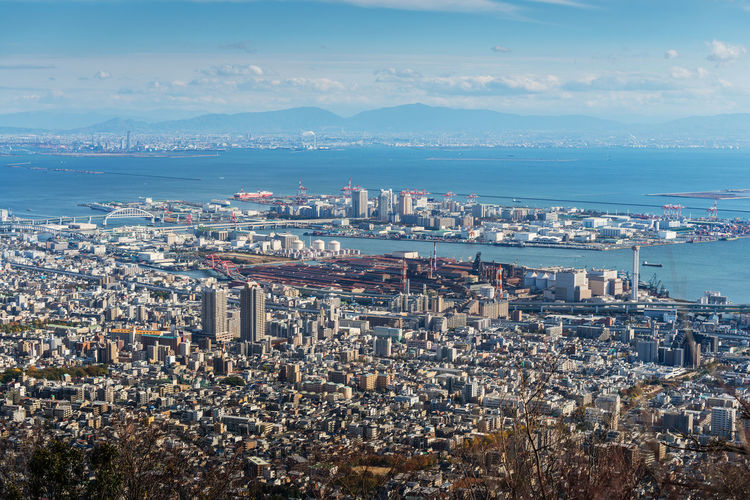 Aerial view of Kobe City,Japan Business Economy Harbor Industrial Skyline Aerial View Architecture Bay Building Exterior Built Structure City Cityscape Crowded Day High Angle View Mount Maya Mountain Nature Ocean Outdoors Sea Sky Skyscraper Technology Urban