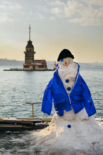 Snowman Against Maiden Tower During Winter