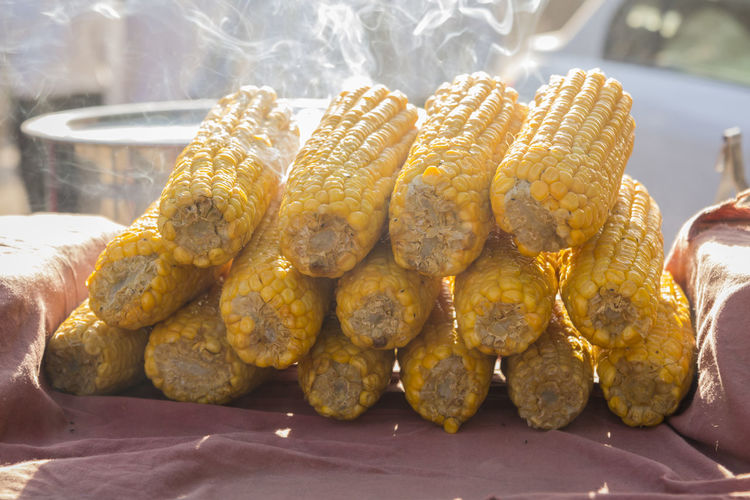 pile of corn boil on food stall in market, New Delhi, India Close-up Corn Focus On Foreground Food Stall Fresh Hot Indiapictures Meal Snack Street Food Temptation
