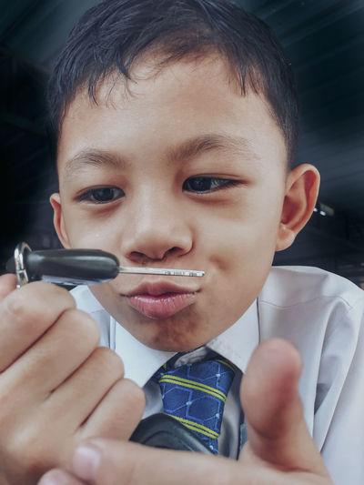 Close-up of boy holding car key