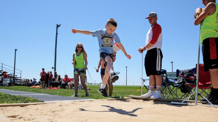 Meridian Elementary School Track & Field Day May 12, 2017 Daykin, Nebraska Action Shot  Community Elementary Age Elementary School Everyday Lives Fun And Games Jumping Jumping Shot Kids Having Fun Kidsphotography Lifestyles Long Jump Low Angle View My Neighborhood Outdoors Photo Diary Real People Rural America School Small Town America Small Town Stories Sports Storytelling Track And Field Visual Journal