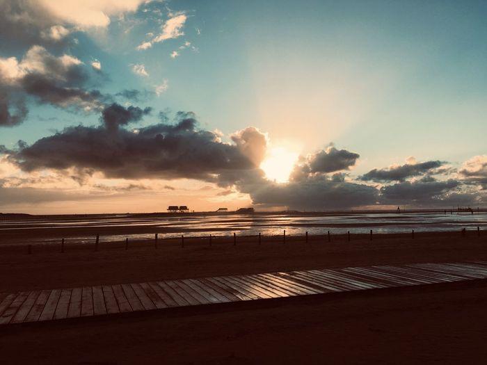 Sky Water Sea Cloud - Sky Beauty In Nature Scenics - Nature Land Beach Tranquility Tranquil Scene Sunset Nature Horizon Horizon Over Water Idyllic Sand No People Sunlight Outdoors
