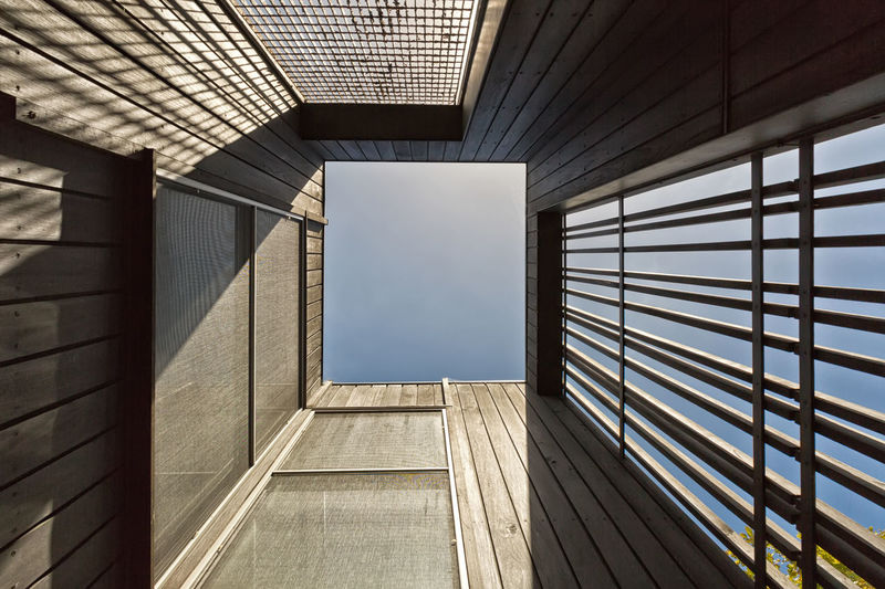 Urban Geometry, looking up to wooden building. Architectural Feature Architecture Architecture Architecture_collection Built Structure Construction Day Lines Lines And Angles Lines And Shapes Lines&Design Lines, Shapes And Curves Looking Lookingup Modern No People Pattern Structure