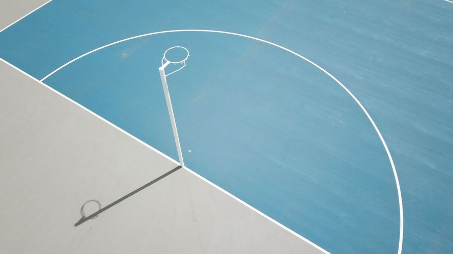 Exercise Lines Lines And Shapes White Copy Space Shadow Shape Sport Australia Pole Basketball Netball EyeEm Selects Sport High Angle View Court Day No People Absence Net - Sports Equipment Basketball - Sport Competition Competitive Sport Blue Outdoors Empty Curve Shape Tennis Yard Line - Sport