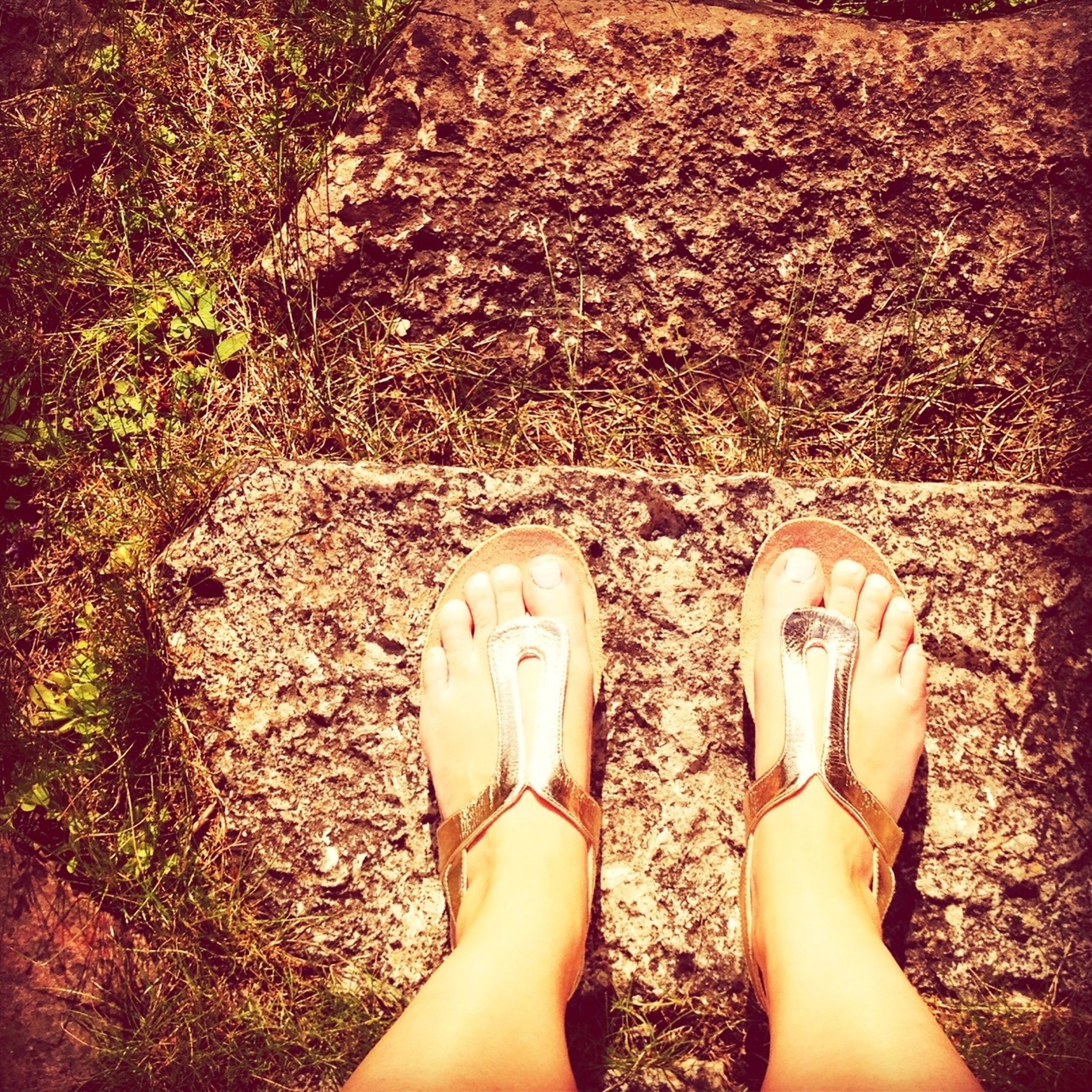 low section, person, personal perspective, human foot, shoe, standing, lifestyles, barefoot, leisure activity, high angle view, footwear, relaxation, human limb, femininity, legs crossed at ankle, outdoors