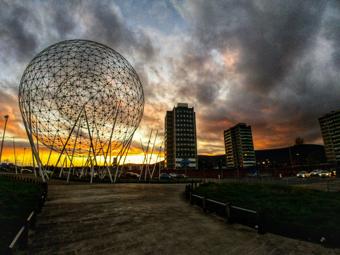 Modern cityscape against sky at dusk