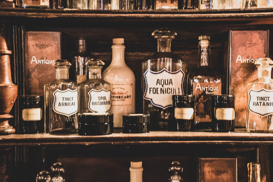 Bottle Container Text Food And Drink Shelf Bar - Drink Establishment Indoors  Glass - Material Drink Western Script Choice No People Variation Refreshment Alcohol Label Still Life Communication Wood - Material In A Row Glass Old-fashioned Retro Styled Retro EyeEmNewHere