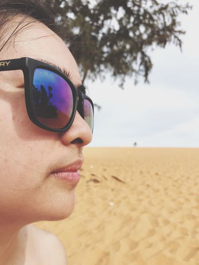 EyeEm Selects Sunglasses Beach Sand Real People Leisure Activity Lifestyles Protection One Person Nature Day Young Adult Sea Vacations Sky Young Women Outdoors Close-up Eyeglasses  Water Portrait Lady Holiday Connected By Travel