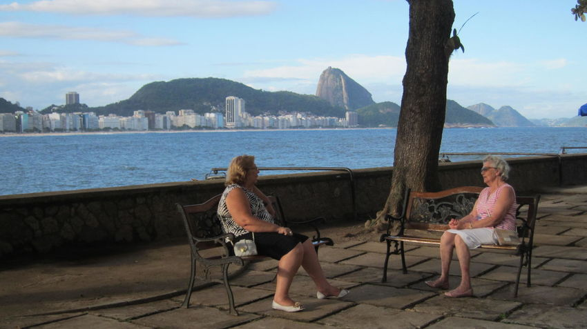 Casual Clothing City Cloud Cloud - Sky Copacabana Fort Day Full Length Leisure Activity Lifestyles Mountain Nature Outdoors Relaxation Sitting Sky Sugar Loaf Tourism Travel Destinations Vacations Water