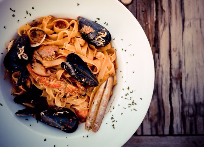 Pasta with mussels on plate