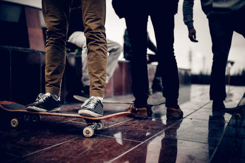 Low section of men standing on floor