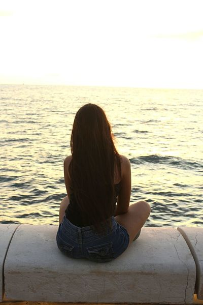 Sea Water Horizon Over Water Leisure Activity Rear View Long Hair Beauty In Nature Nature Tourism Getting Away From It All Beach Sea Water Horizon Over Water Rear View Leisure Activity Beach Lifestyles Person Scenics Tranquil Scene Tranquility Long Hair Beauty In Nature Getting Away From It All