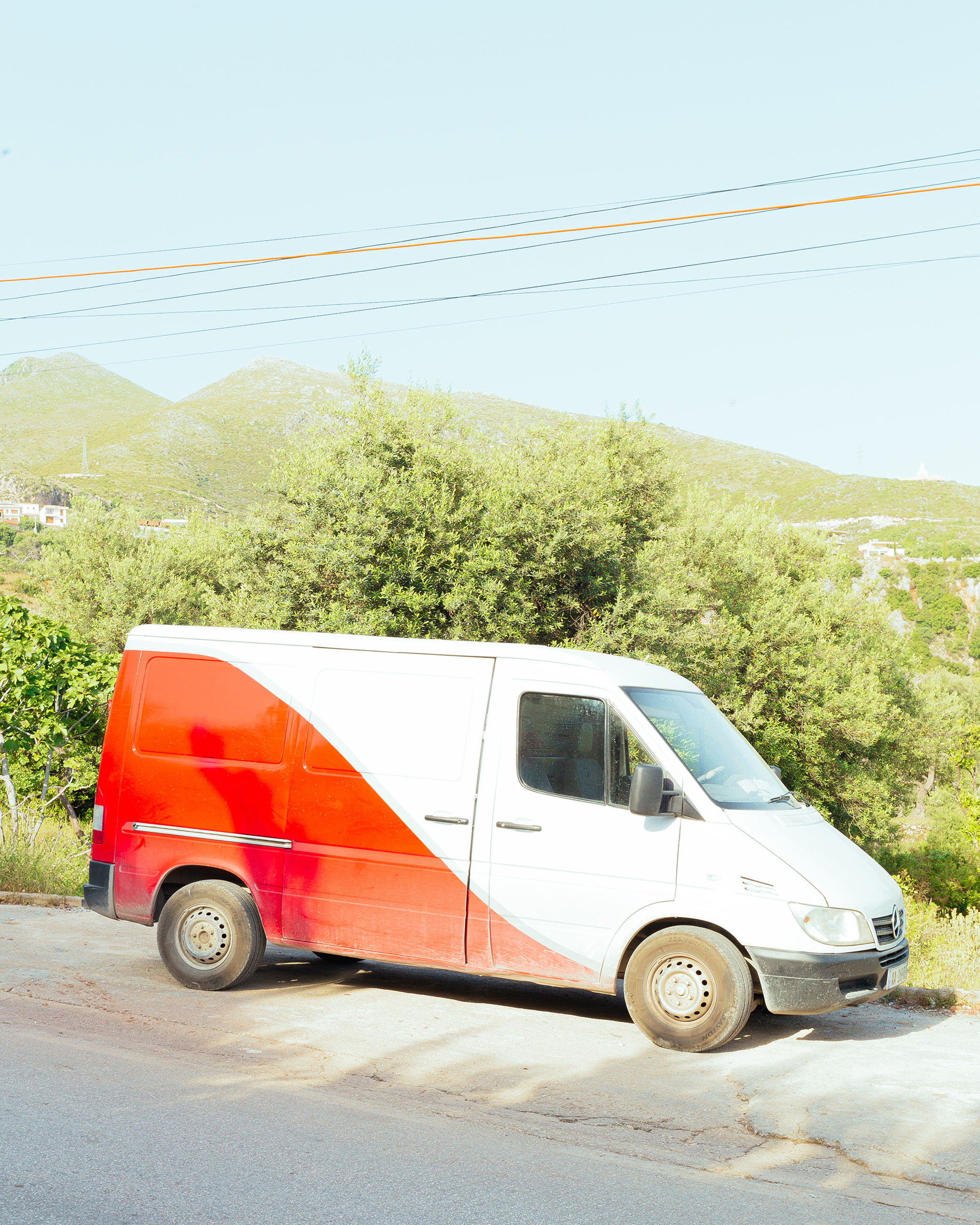 transportation, mode of transportation, land vehicle, motor vehicle, car, road, day, no people, nature, tree, plant, stationary, sky, red, clear sky, mountain, street, van - vehicle, white color, travel