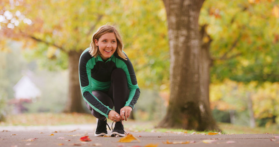 Autumn Casual Clothing Change Day Exercising Focus On Foreground Full Length Green Color Happiness Healthy Lifestyle Leaf Leisure Activity Lifestyles Looking At Camera Nature One Person One Woman Only Outdoors Park - Man Made Space Portrait Real People Smiling Tree Women Young Women