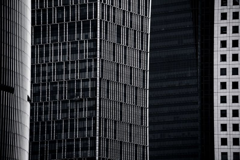Shanghai Architecture Black and White Series Devil In The Detail Arc Bw Cityscape Architecture_collection Bnw_captures Bw_collection BW_photography EyeEm Selects Built Structure Building Exterior Architecture Building Office Building Exterior Office Low Angle View Modern City No People Window Glass - Material Tall - High Full Frame Skyscraper Pattern Reflection Backgrounds