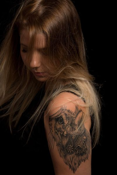 Young woman with cat tatoo Tattoo Black Background Blond Hair One Person Studio Shot Only Women People Long Hair Human Body Part One Woman Only Beauty Beautiful Woman One Young Woman Only Portrait Close-up Studio Photography AMP PICTURES