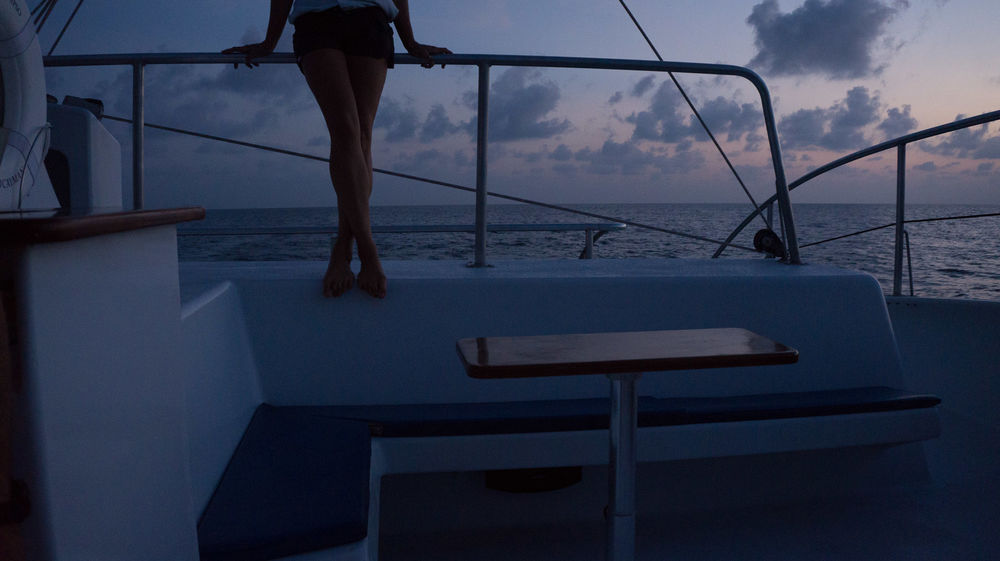 woman lean on boat railing Beauty In Nature Boat Catamaran Close-up Dusk Horizon Over Water Lifestyle Low Section Luxury Nature Nautical Nautical Theme Nautical Vessel Outdoors Paradise Real People Sailing Scenics Sea Sky Sunset Tranquility Travel Photography Water Let's Go. Together.