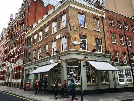 Architecture Building Exterior Built Structure Window City Day Outdoors Travel Destinations Real People Men People Adults Only Adult Sky Shop Design Outdoor Shopwindow Cornerarchitecture Corner Corner Store Corner Shot London City Life Cityscape