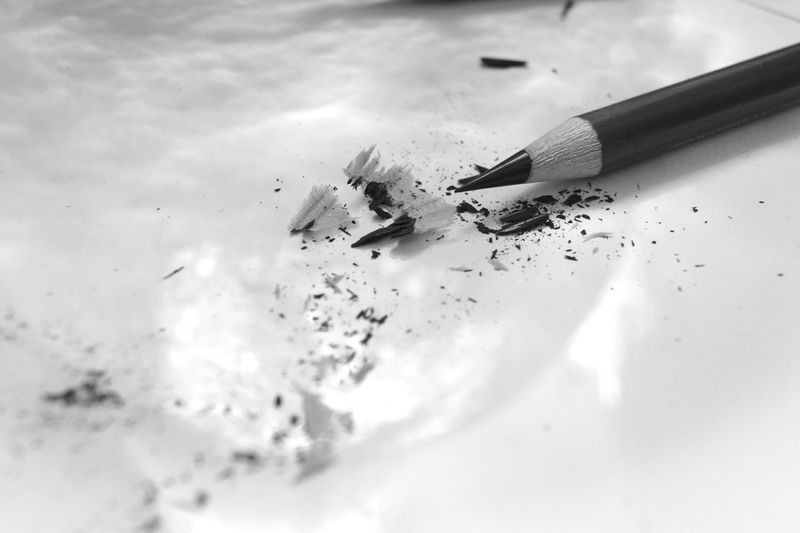 Close-up of pencil with shavings on table