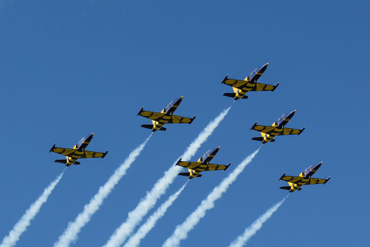 Aerobatics Air Force Air Vehicle Airplane Airshow Arrangement Baltic Bees Baltic Bees Jet Team Blue Clear Sky Day Fighter Plane Flying Formation Flying Low Angle View Military Military Airplane No People Outdoors Sky Smoke - Physical Structure Speed Teamwork Transportation Vapor Trail