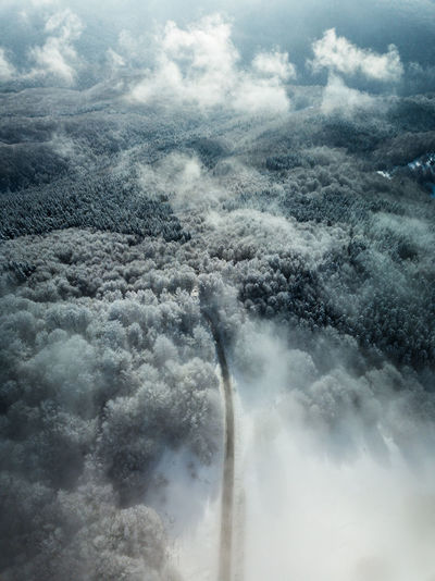 Cloud - Sky Sky Aerial View Environment Scenics - Nature Beauty In Nature Nature No People Air Vehicle Flying Day Airplane Outdoors Cloudscape Transportation Land Mode Of Transportation Water Geology Power In Nature Road Asphalt Nature Nature_collection Mist
