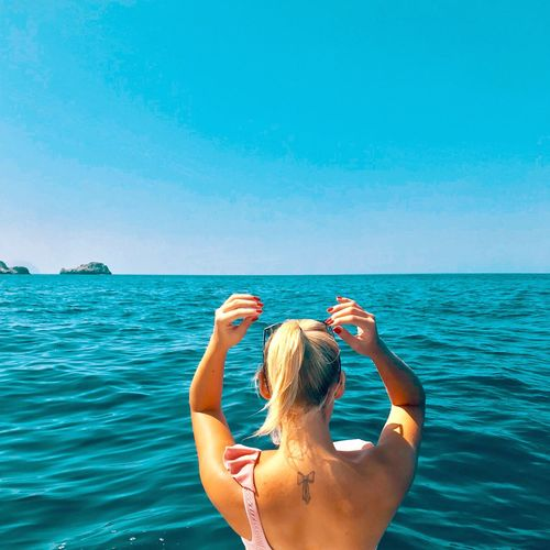 L'IMMENSO BLU Sea Water Rear View Horizon Over Water Horizon Sky One Person Beauty In Nature Nature Blue Tranquility