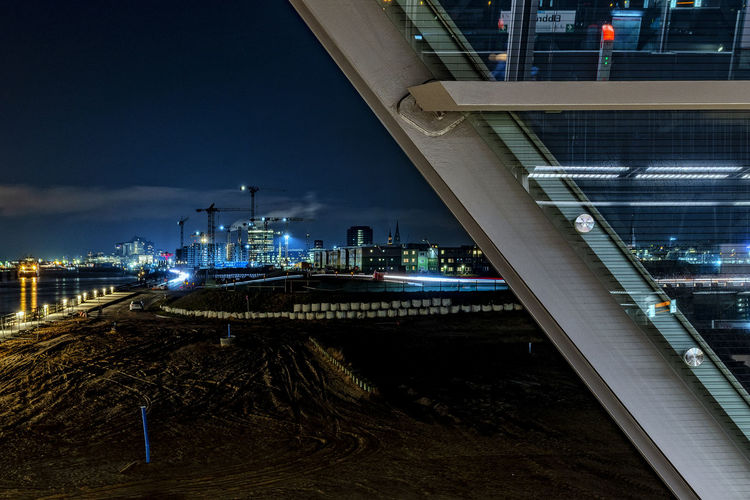 site Steel Girders Long Exposure Hamburg Harbour Subway Station Glass Nightscape Illuminated Night Building Exterior Architecture Built Structure Transportation Sky No People Nature City Water Connection Outdoors Business Mode Of Transportation Bridge Skyscraper Elbe