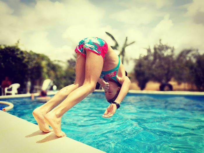 Swimming Pool Water Summer Vacations Swimwear People Leisure Activity Outdoors Swimming Lifestyles Relaxation Beautiful People Day Jump In The Pool Jump In The Water  Kids Being Kids Kids Playing