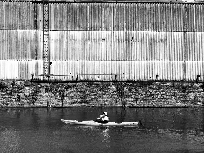 Man in boat against river