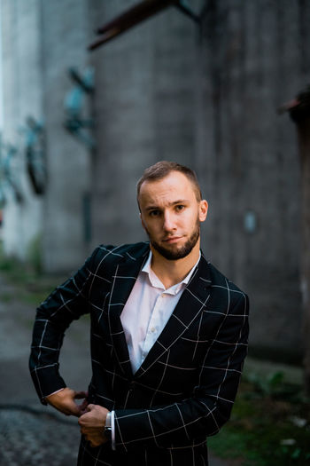 Man Stylish Architecture Beard Building Exterior Built Structure Contemplation Day Focus On Foreground Front View Lifestyles Looking At Camera Males  Man Fashion Man Style Mid Adult One Person Outdoors Portrait Real People Standing Style Waist Up Young Adult Young Men