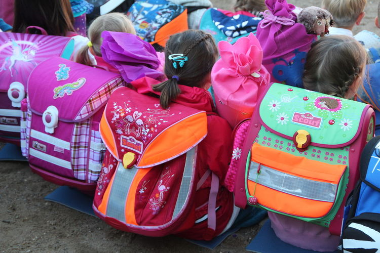 Einschulung Childhood Rear View Group Of People Child Girls Sitting Real People Women Incidental People Day People Transportation Group Females Pink Color Toy Leisure Activity Casual Clothing Medium Group Of People Adult Innocence Hairstyle School