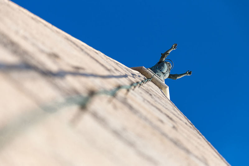 Bungee jumping !? Architecture Art Art And Craft Blue Building Exterior Built Structure Clear Sky Copy Space Creativity Day Human Representation Low Angle View No People Outdoors Sculpture Statue Sunlight
