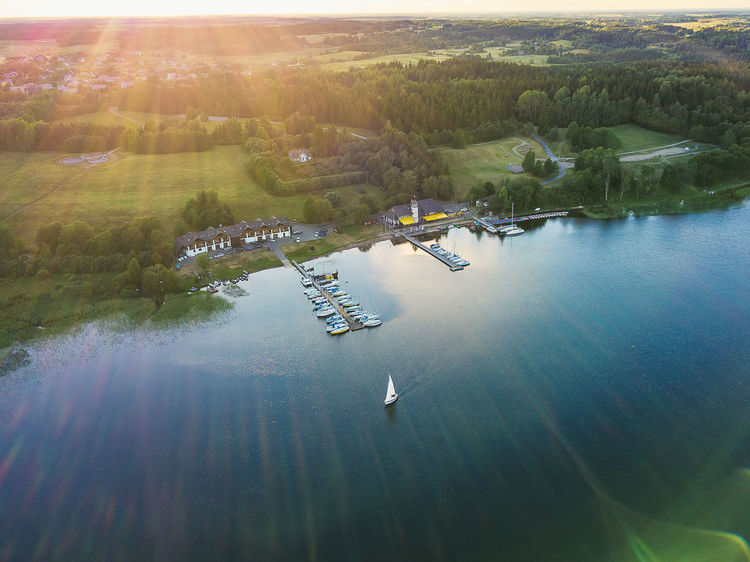 Yacht club Aerial Shot Drone  Lietuva Aerial Aerial View Beauty In Nature Day Drone Photography Europe High Angle View Lake Lens Flare Mavic Mavic Pro Mode Of Transportation Nature Nautical Vessel No People Outdoors Plant Reflection Scenics - Nature Sky Sunlight Tranquil Scene Tranquility Transportation Tree Water Waterfront Yacht Club The Traveler - 2018 EyeEm Awards