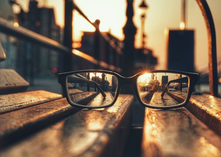 Close-up of eyeglasses on bench