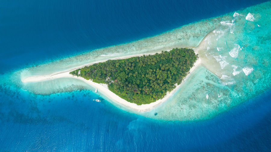 This island is found in the beautiful Vaavu Atoll Maldives. an uninhabited island as of now. Island View  Water Sea Nature Aerial View Day No People Land Scenics - Nature Beauty In Nature Waterfront High Angle View Wave Turquoise Colored Outdoors Blue Beach Island Travel Destinations