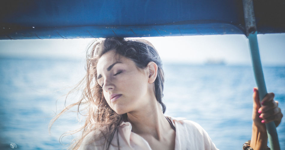 Focus On Foreground Hair Headshot Indian Ocean Leisure Activity Lifestyles Ocean Person Romantic Sailing Sea Wind Young Adult Young Women Zanzibar
