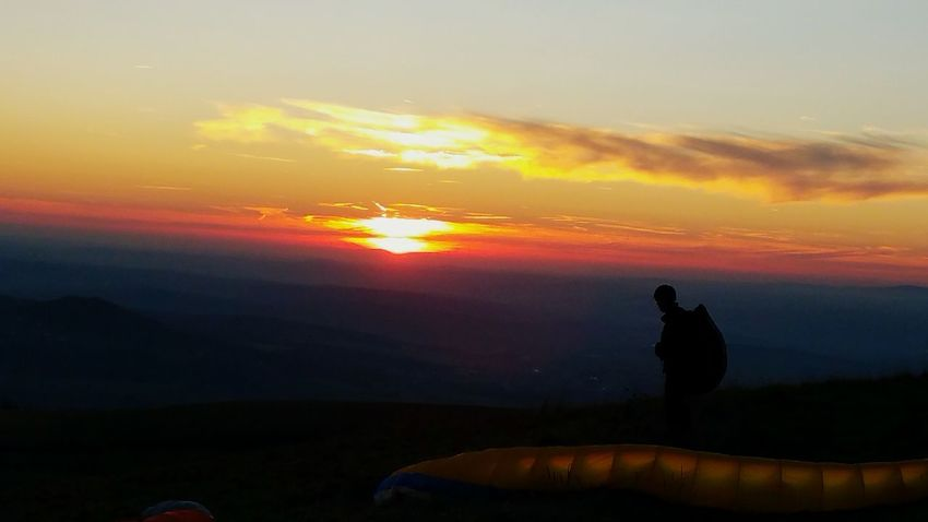 Paragliding In The Mountains Sunset And Clouds  Colored Sunset Paragliding Sunset Silhouette Rural Scene Sky Cloud - Sky Landscape Romantic Sky Calm