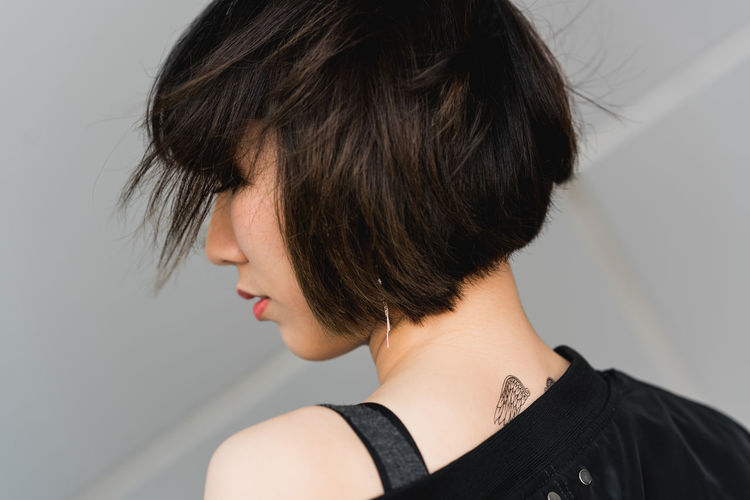 Rear view of woman with short hair
