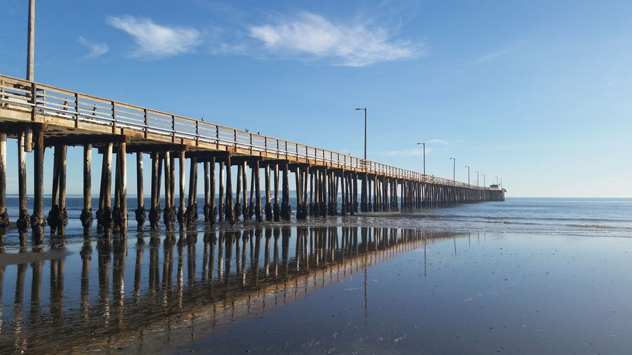 Reflection Sea Beach Water Sky Pier Outdoors Architecture Day Horizon Over Water Wooden Post Bridge - Man Made Structure Tranquility California California Coast Avila Beach CA No People Built Structure Nature Groyne
