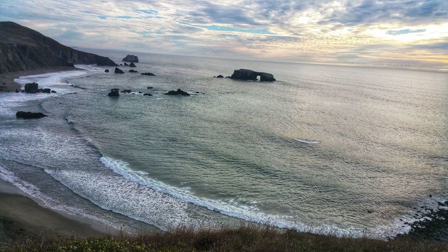 My thinking spot. Cliffs overlooking the ocean. Atmospheric Moody Sky Dramatic Golden Pink Glowing Lacey Lace Countryside Mysterious Clouds Solitude Zen Nirvana Thinking Contemplating Cliffs Moment High Aerial Above Far Below Ocean Beach Waves Frothy Curved  Background Pink