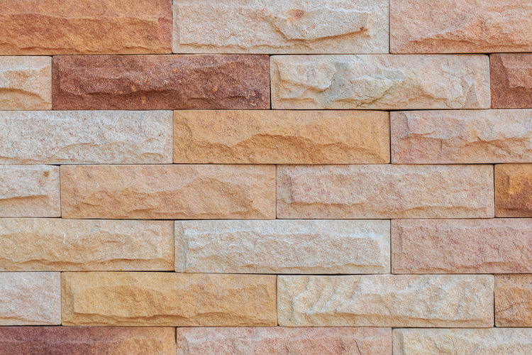 Sandstone wall background Architecture Backgrounds Brick Brick Wall Brown Built Structure Close-up Day Flooring Full Frame No People Outdoors Pattern Rough Solid Stone Material Stone Wall Textured  Tile Wall Wall - Building Feature