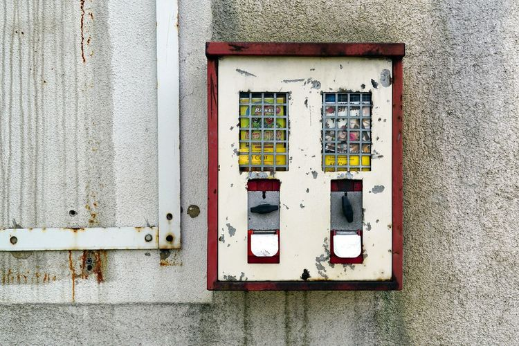 Close-up of telephone booth on wall