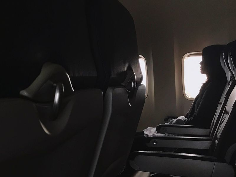 Mid flight nap. Transportation Mode Of Transport Sitting Travel Window Indoors  One Person Day Young Adult Close-up People Airplane Air Travel  Plane Plane Interior Traveling