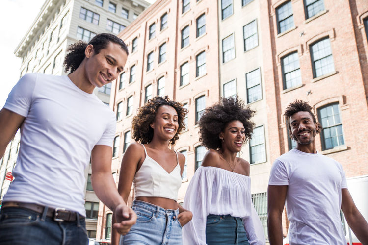 Group of friends spending time in New york city Friends Friendship America People Water Man Lifestyles New York Manhattan Brooklyn Colors Street Urban New Yorker Wall African American Happiness Fun Crew Group Laughing Smile Good Mood