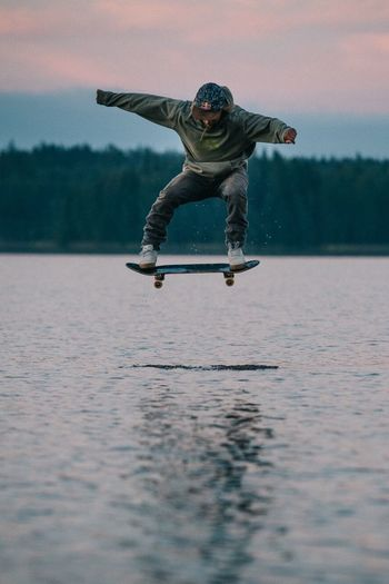 Adventure Club Skating on a rock just below the surface of this Finnish  lake. Roope Tonteri and I went out to shoot a portrait in the middle of the water, when he decided to pop a couple of ollies! Good Times Skateboarding Finland