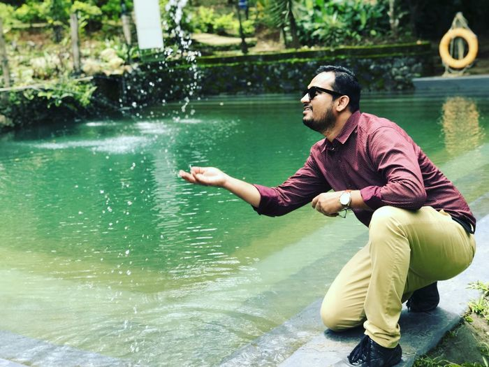 Man playing with water in pond