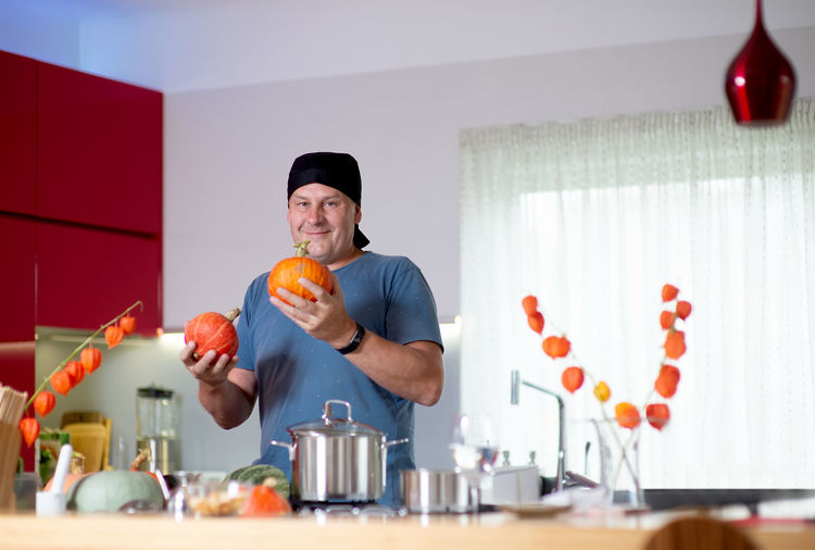 Man holding food on table at home