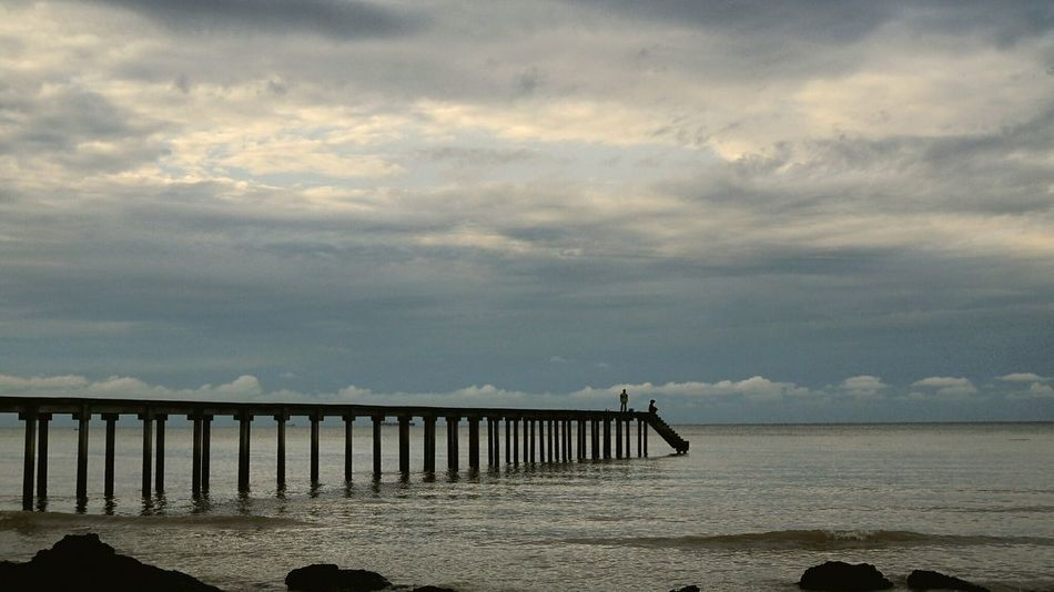 into the sea EyeEmNewHere Jetty Pier Clouds Serenity Calmness Gentle Waves Seaside Sea Morning Sky Beach Sand Cloud - Sky Sea Outdoors Tranquility Sky Day Horizon Over Water Beauty In Nature Water