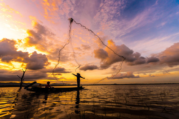 fisherman with golden sky Twilight Sunset Silhouette Gold Golden Morning Thailand Outdoor Fisherman Fishing Occupation Traditional